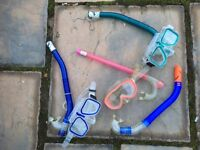 two child snorkels, one adult one, one spare mouth piece and two storage bags