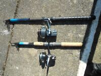 2 telescopic rods with reels,line ready to be fished, spinning and ground fishing