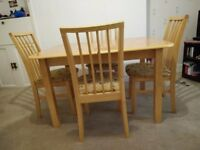 Wooden Dinning Table along with four Chairs. Good Condition. Negotiable.