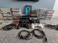 PS3 with 4 controllers and 65 games