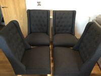 4 stylish charcoal coloured fabric dining chairs with wooden legs