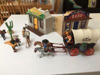 playmobil western bank and sheriff and coerced wagon with raiders