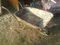 rusty but working wheelbarrow