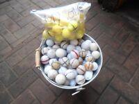 BUCKET OF USED GOLF BALLS