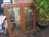 Golden oak upvc window