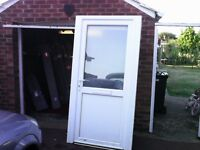 upvc front door with letterbox and key