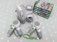 LeapFrog LeapTV with 2 controllers and 5 games. Like New