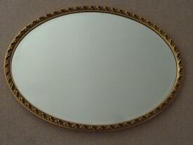 Oval vintage retro bevelled edge gold/gilt framed mirror. (1970s)