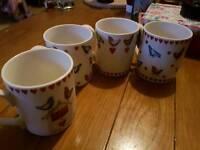 Set of 4 used mugs