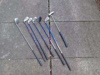 A set of childs golf clubs / boys golf clubs / childrens golf clubs