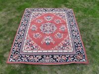 Next Rug in new condition with a traditionnal symmetrical Pattern size 120cm x 165cm