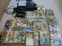 Sony PS3 (320GB) with 34 games.