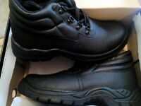 Brand new, boxed size 8 work boots with steel toe caps.