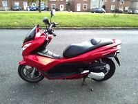 2012 Honda PCX 125 automatic scooter, 1 year MOT, runs very well, new tyre, new battery, new pads,,,