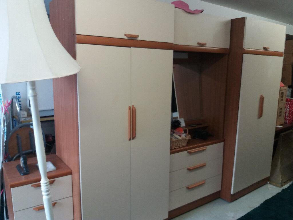 cream and wood veneer wardrobe set.