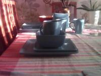 Set of crockery-square shaped turquoise plates,bowls,(4 of each),matching mugs.In good condition