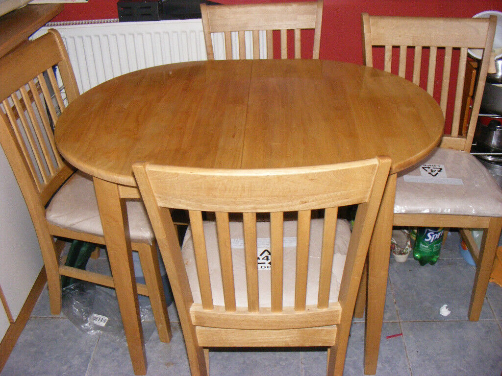 oak dining room table and 4 chairs as new