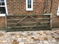 Two wooden gates 10ft ( 305cm) wide each and one single gate 3ft (92cm) wide.