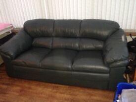 Green leather three seater sofa