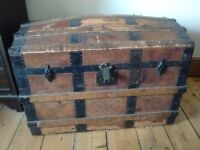 Wooden travel trunk, leather covered (battered), probably Victorian