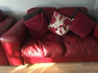 For sale 2&3 red leather sofas & pouffe, good condition £200