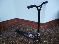 STUNTED brand sports scooter with stunt pegs in excellent condition.