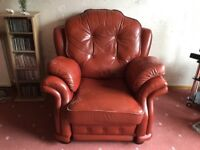 Leather reclining armchair, wine colour.