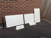 Two white color Ikea coffee tables