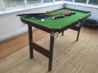 A folding child size snooker/pool table with all accessories included.