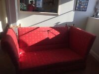 2- seater sofa. Very sturdy, good condition. Red colour with navy/gold print.