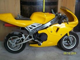 Yellow mini moto with engine