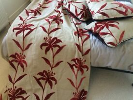 Four full length curtains with 3 matching cushions in excellent condition.Fully lined