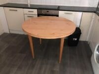 Wardrobes, single and double. Round dining table and glass coffee table
