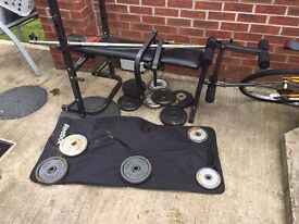 Weight bench with weights and mat.