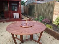 Wooden 6 Seater Garden furniture with red accessories