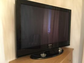"""42"""" Samsung Plasma TV with stand. In perfect working order."""