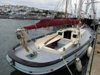 Gaff rig sail heritage fishing boat `seafish` LN236 moored Brixham inner harbour