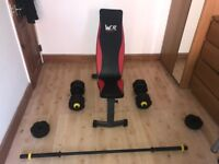 Workout bench, barbell and dumbbells