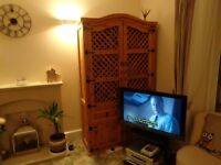 Pine Cabinet. Mexican pine, lattice design with shelves , drawers and cupboards.