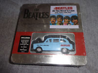 BEATLES LIMITED EDITION TIN/WALL PLAQUE/T SHIRT/TAXI SEALED