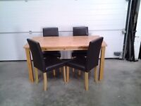 New set 4 dining chairs, black faux and FREE wood dining table if wanted. Bargain, can deliver.