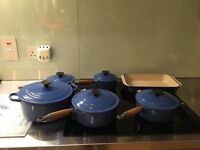 Six piece Le Creuset blue enamel set 5 saucepans with lids and one roaster