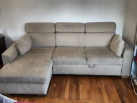 Corner Sofa Bed with storage for bedding and headrests