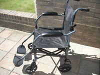 As new Liteweight Wheelchair with wheeled carry bag