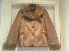 Faux fur lined shearling coat.