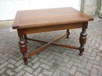 Oak Dining Table. C 1930. Solid polished hardwood . Extending leaves. Bulbous legs stretcher base .