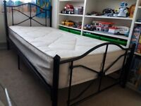 Single bed, black metal frame with comfy mattress
