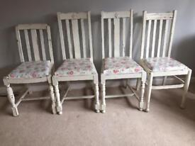 Four distressed chairs with Cath Kidston oil cloth seats