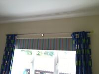 A pair of children's curtains and pole