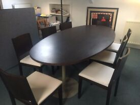 Dark brown wooden table with 8 chairs